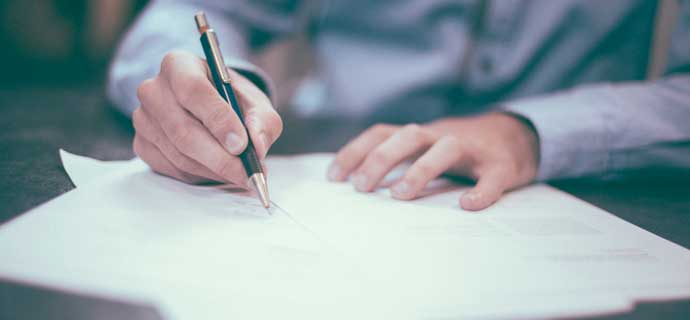Healthcare Administrator Signing a Contract