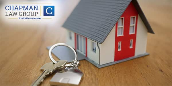 Image of a house and keys representing estate planning.