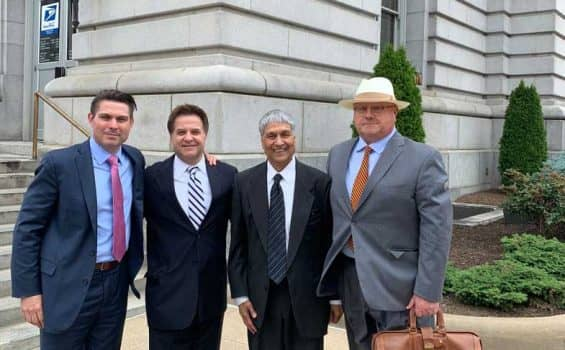 Ronald W. Chapman II outside of a court house with his clients who he was respresenting in a health care fraud trial.