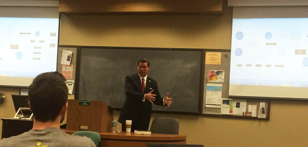 Image of Ronald W. Chapman presenting a seminar on health care law at Stetson University.