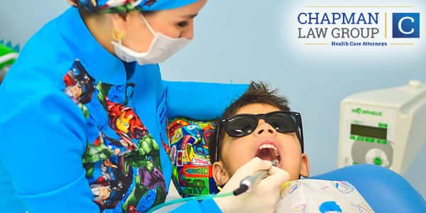 Image of a Dentist working on a child.