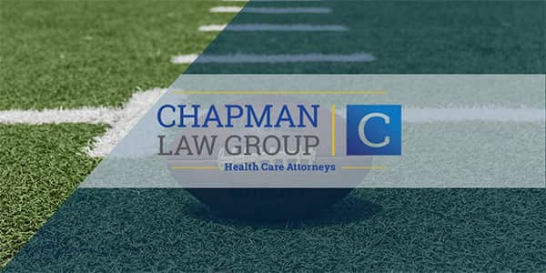 Image of a football on a football field and the Chapman Law Group logo.