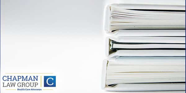 Image of a stack of books in reference to proper medial billing.