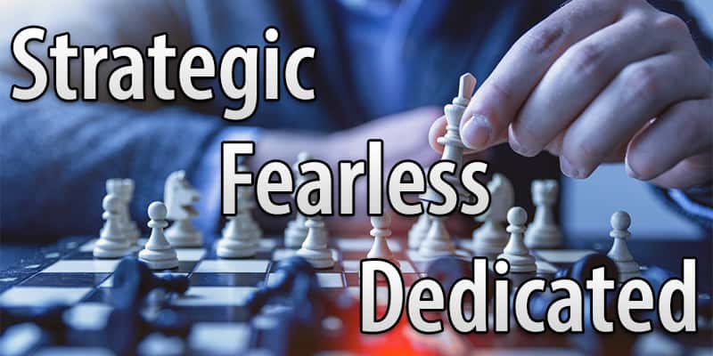 """Image of a chess player playing chess with the word """"strategic"""", """"fearless"""", and """"dedicated"""", in reference to the legal theory and practice that our health care fraud defense attorneys used when defending an opthalmologist in a reimbursement dispute."""